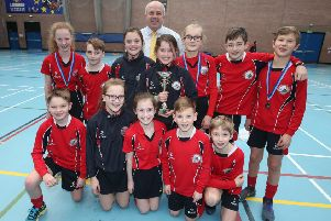 Chairman of Lisburn & Castlereagh City Council's Leisure & Community Development Committee, Alderman James Tinsley is pictured at the recent Sports Hall Athletics competition held at Lagan Valley LeisurePlex with Overall School Winners, Moira Primary School.
