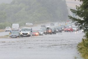 Motorists on the A1 dual carriageway at Dromore, Co Down, being confronted with a lake across the lanes on Saturday
