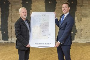 Pictured unveiling plans for the latest addition to the Beannchor Group's hotel portfolio are Bill Wolsey, MD of Beannchor and Nicky McCollum, development director at Lisburn Square.