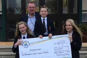 Holly, Bonnie and Toby Latewood held a fundraising party at Lisburn Golf Club in appreciation of the care that Bonnie received recently'during a stay in Paul Ward in the Royal Belfast Hospital for Sick Children.'They are pictured here presenting over the proceeds of  �10,800.