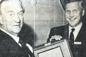 Mr FC Tughan who retired as Chairman of the Ulster Scottish Assurance Group in 1970 admiring the humidor which was presented to him by Mr T D Lorimer on behalf of the directors and staff.