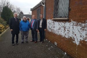 Rev Alan Smylie, Billy Smyth, chairman of the Seymour Hill and Conway Community Association, DUP councillor Jonathan Craig and Edwin Poots MLA at the scene of a graffiti attack at Dunmurry Free Presbyterian Church.