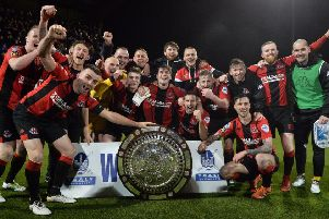 Crusaders celebrate success in the dramatic Toals County Antrim Shield final with a 4-3 win over Linfield. Pic by Pacemaker.