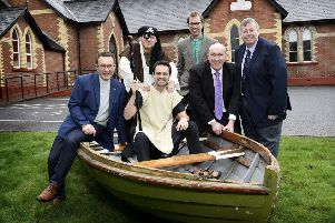 (L-R) Ven Paul Dundas, Christ Church; Chris Neilands, Play it by Ear; Ross Jonas, Play it by Ear; Rev Derek Harrinngton, Christ Church; Alderman William Leathem, Chairman of the council's Development Committee and Alderman Paul Porter, Chairman of the council's Leisure & Community Development Committee.