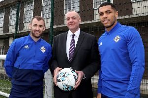Northern Ireland's Niall McGinn and Josh Magennis with Maghaberry Prison governor David Kennedy during their visit to the 'Stay Onside' programme at HMP Maghaberry