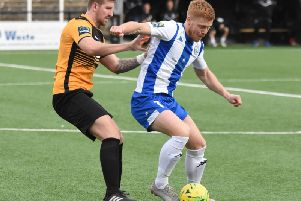 Trevor McCreadie holds the ball up under pressure in Haywards Heath Town's 2-2 away draw at Cray Wanderers. All pictures by Grahame Lehkyj.