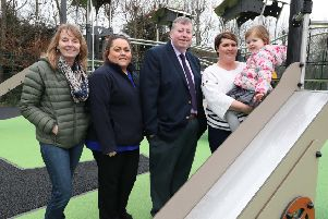 Alderman Paul Porter, Chairman of the Council's Leisure & Community Development Committee is pictured in the refurbished Queen Elizabeth II Play Park with Melanie Glasgow, Ballymacash Regeneration Network; Councillor Amanda Grehan, Deputy Mayor; Sophie Rainey and Jillian Morris.