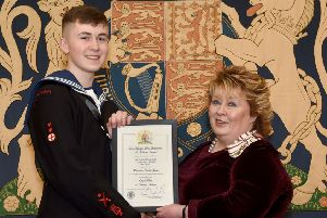 Able Cadet Bobby Seawright is pictured accepting his award certificate from Mrs Fionnuala Jay-O'Boyle, Her Majesty's Lord Lieutenant for the County Borough of Belfast.