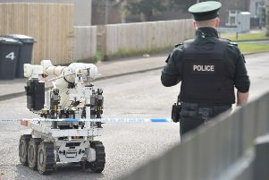 Police and ATO at the scene of a security alert in the Rathvarna Drive area of Lisburn on Wednesday