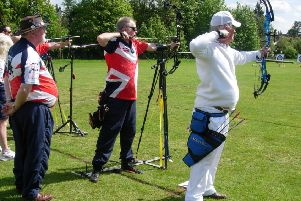 Louth clubmates Stuart and Pete on the shooting line watched by spotter Rick Smith EMN-190516-120839002