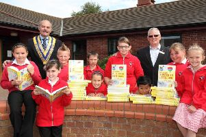 Pictured, from left, were Lauren Packer, 10, Rotary president David Platt, Lexi Cunliffe, eight, Hayden Lawson, 10, Elliott Margerison, 10, Casey Parker, seven, Lucy-Anne Smith, 11, Sam Phromsurin, eight, Rotary community and vocational officer Tony Tye, Amy Groocock, 10 and Alisha Browne, 10.