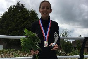 Kelly Edwards shows off her British Masters 5k winnings.