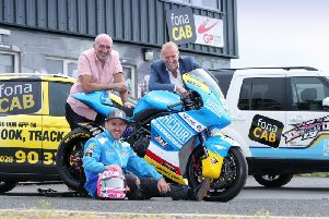 Top road racer Lee Johnston with Ulster Grand Prix Clerk of the Course, Noel Johnston, and William McCausland, Managing Director, fonaCAB.