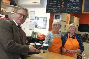 Rugby MP Mark Pawsey with volunteers at Moriartys Caf and Art Gallery.