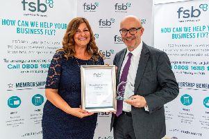 Sandra Garlick, FSB Area Lead for Warwickshire and Coventry presenting the award to Matt Western MP for Warwick and Leamington