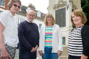 Left to right, Tricia Scott, Rick Thompson, Christine Shaw and Helen Fellows next to the towns war memorial. Photo submitted