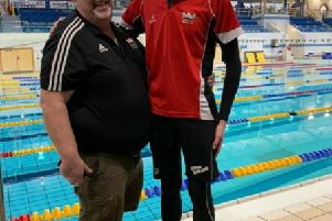 Martin J McGann, Head Coach of Lisburn City Swimming Club pictured celebrating with Daniel Wiffen