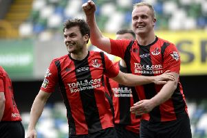 Crusaders' Philip Lowry (left) and Jordan Owens. Pic by PressEye Ltd.