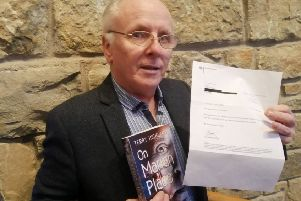 Author Terry Hickland with his book and letter he received from German Chancellor Angela Merkel
