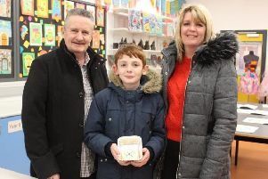 Conor Maguire P7 from St Joseph's Crumlin with mum Alison and dad Ricky