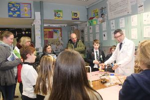 Current Year 8 Pastoral Leader and Science teacher Mr McCormick demonstrating in the very busy Science Department at the Fort Hill Integrated College Open Day