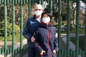 Stephen Graham and his wife, Christina Wu, enjoy a walk in Shanghai