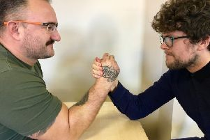 Armwrestling champion Daniel Tutt, from Western Row, Worthing, faces off against Herald reporter James Butler