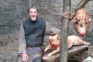Kenny with two sows he bred to look 'iron age' for Game of Thrones