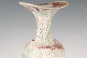 A Lucie Rie studio pottery stoneware bottle with flared asymmetrical rim and ovalled neck, covered in a pink and blue volcanic glaze. SUS-190121-113820001