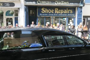 The hearse carrying John's coffin outside his shop. Picture by Andrew Clifton SUS-181005-123351001