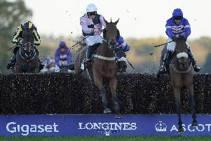 Josh Moore and Traffic Fluide, centre, clear the last to win the Sodexo Gold Cup Handicap Chase at Ascot in November