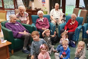 Residents of Abbotswood Extra Care Housing in Rustington with their new friends from The Playcentre