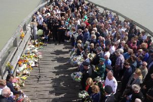 A memorial service held to remember the 11 men that died in the Shoreham Airshow crash