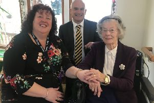 Resident Laura Stevens with home manager Angie Douglass and Russell Brown, Shaw healthcare's chief financial officer,  at The Martlets