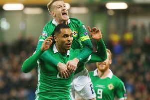 Northern Ireland captain Steven Davis celebrates with Josh Magennis, after the substitute fired home their late winner against Belarus.