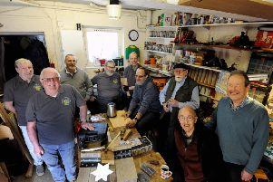 James Spanner, chairman of Littlehampton East Men in Sheds, right, and Brian Greaves, secretary, front left, with members. Picture: Kate Shemilt ks190167-2