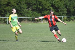 A Rustington player shapes to play the ball forward against Westfield