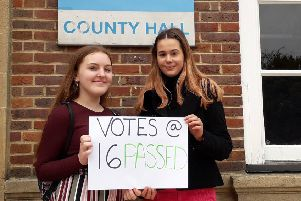 Members of the West Sussex Youth Cabinet Holly Thompson and Ellie Roberts celebrate county councillors backing votes for 16 and 17 year olds