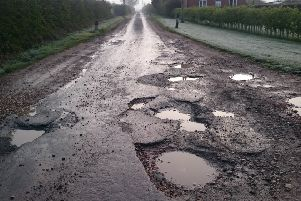 Potholes on Abbey Lane, near Woodhall Spa. EMN-190404-151208001