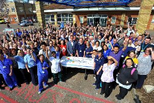 Staff outside Worthing Hospital celebrating the milestone. Picture: Steve Robards