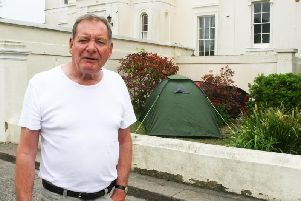 Robin Biggs is not happy about the tents outside Beach House. Picture: Derek Martin