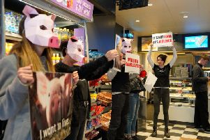 Vegan activists in Greggs, Brighton (Credit: DxE Brighton)