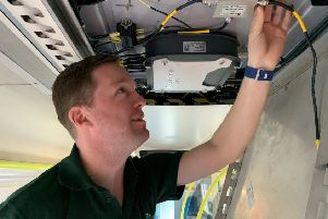 GTR Wireless Systems Engineer Robin Hayman inspects Wi-Fi fitted to the final Southern units