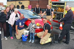 Littlehampton firefighters with Morrisons community champion Alison Whitburn and CLIC Sargent supporters. Photo by Derek Martin DM1951761a