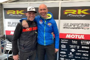 John Burrows with former Burrows Engineering rider Davey Todd at the paddock on Friday afternoon.