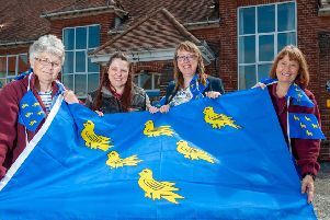 Organiser Julie Roby, right, gets some help from volunteers as she prepares for the Wick Village Sussex Day celebration. Picture: Scott Ramsey