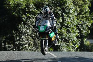Michael Dunlop at Ballaugh Bridge on his way to his 19th Isle of Man TT win in the Lightweight race.
