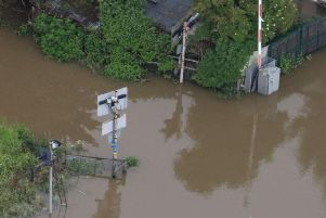 A flooded crossing gate on the line between Boston and Skegness