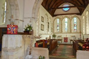The Pentecost falls on the front of the altar and pulpit at St Mary's Church in Clymping