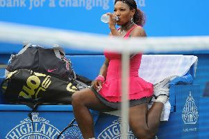 EASTBOURNE, ENGLAND - JUNE 15:  Serena Williams of USA rests between games against Vera Zvonareva of Russia during day five of the AEGON International at Devonshire Park on June 15, 2011 in Eastbourne, England.  (Photo by Mike Hewitt/Getty Images) SUS-190306-141124002